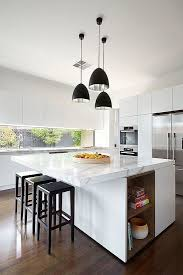 contemporary white kitchen with white marble countertops black