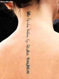 Awesome Arabic Tattoo On Spine