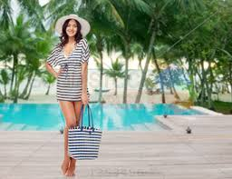 Stock Photo Of People Fashion Summer And Beach Concept Happy Young Woman In Clothes Sun Hat With Bag Over Swimming Pool At Res