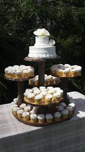 Nature Inspired Log Wedding Cake And Cupcake Display