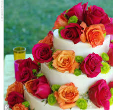 Floral Cake Display With Orange And Fuchsia Colors