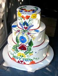 A Mexican Themed Wedding Cake Looks Like The Embroidery On Dresses And Blouses Very Colorful