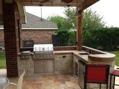 Small L Shape Outdoor Kitchen With Bar Seating