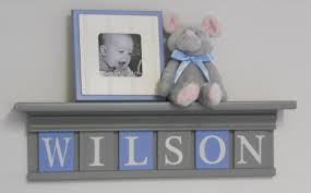 grey shelf with light blue and gray wall letters