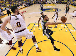 Golden State Warriors Guard Stephen Curry Right Shoots Against Cleveland Cavaliers Forward Kevin Love 0 During The First Half Of Game 2 Basketballs