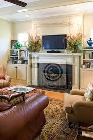 fototapete gemütliches wohnzimmer mit kamin und plasma fernseher