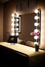 vanity table with lights around mirror ongpl home