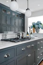 Fabulous Kitchen Features Dark Gray Cabinets Painted Porters Paint Bronze Paired With Luce Di Luna Quartzite Countertops And A White Beveled Subway