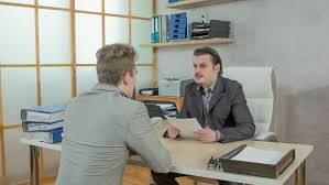 bureau vall guing businesspeople after a phone call in an office stock footage