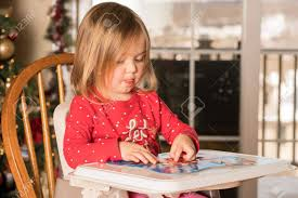 Young Female Baby Girl In High Chair Making A Jigsaw On A Plastic ... Baby High Chair Camelot Party Rentals Northern Nevadas Premier Wooden Doll Great Pdf Diy Plans Free Elephant Shape Cartoon Design Feeding Unique Painted Vintage Diy Boho 1st Birthday Banner Life Anchored Chaise Lounge Beach Puzzle Outdoor Graco Duo Diner 3in1 Bubs N Grubs Portable Award Wning Harness Original Totseat Cutest Do It Yourself Home Projects From Ana Contempo Walmartcom