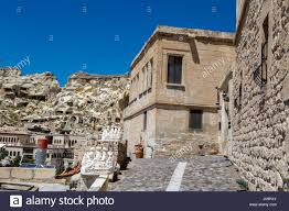Landscape View Of Famous Historical Urgup Valley With Sandstone Caves And Limestone Buildings On Bright Blue Sky Background