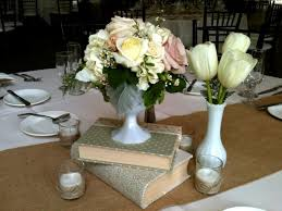 Beautiful Vintage Wedding Centerpiece With Books And Milk Glass By Soleil Flowers Temecula CA