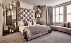 a sumptuous bedroom design with beautiful pendant fixtures