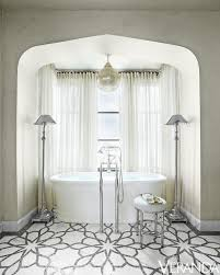 Tiling A Bathtub Alcove by Arched Tub Alcove With Oval Tub Transitional Bathroom