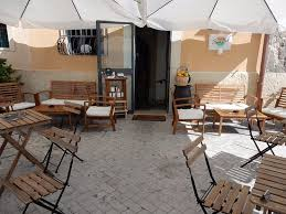 Outdoor Dining Room Table Restaurant Entrance Faces Water Foto Di Sunset