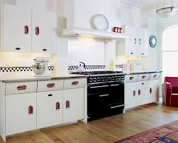 Retro 50s Kitchen Decor Withwhite Wooden Cabinet And Small Round Wall Clock Also White