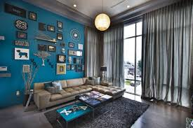 comfy blue living room decor with dark wooden flooring and hidden