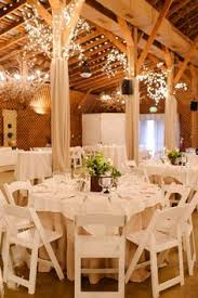 Chic White Chairs And Simplecenterpieces Wedding Tablescape