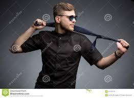 stylish man in black shirt and mirrored sunglasses stock photo