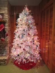 white tree with colored lights happy holidays