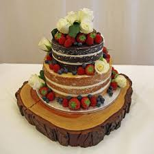 Naked Wedding Cake On A Tree Slice Stand