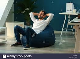 Young Businessman Sitting On Beanbag Chair In Office Stock ... Lumisource Andrew Contemporary Adjustable Office Chair Beanbag Interior Stock Photo Edit Now 1310080723 Details About Loungie Sofa 3 In 1 Ottoman Floor Pillow Linen Or Sherpa Fabric Businesswoman Using Laptop Bean Bag Chair Office Hot Item Mulfunction Lazybones Lazy Bean Bag Household Computer Cy300 Versa Table Lcious Grey Indoor Interstuhl Movy High Back Modern Executive Ideas For News Under The Hood Of 2017 Bohemian Softrock Living Super Study Jxsolo Bean Bag Desk Chair Not Available Anymore See Get Acquainted With Zanottas Italian Flair Indesignlive