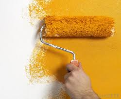 A Person Painting Basement