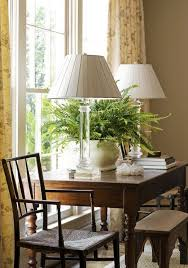 Glass lamps look great on this desk See them at St Martin s