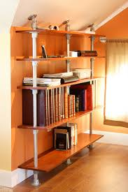 a pole mounted bookshelf built with kee klamp pipe and wooden