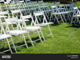 Rows White Folding Image & Photo (Free Trial) | Bigstock White Chair Juves Party Events Wooden Folding Chairs Event Fniture And Celebration Stock Amazoncom 5 Commercial White Plastic Folding Chairs Details About 5pack Wedding Event Quality Stackable Chair Can Look Elegant For My Boda Hercules Series 880 Lb Capacity Heavy Duty With Builtin Gaing Bracke Mayline 2200fc Pack Of 8 Banquet Seat Premium Foldaway Utility Sliverylake Foldable Steel Rows Image Photo Free Trial Bigstock