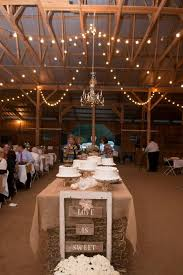 Rustic Wedding Cake Table Down The Middle Of Barn