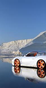 Orange wheels on the white car HD wallpaper