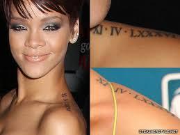 Rihanna Roman Numeral Chest Tattoo