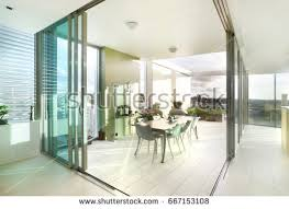 Dining Area Close To City View Comfortable Furniture With Designs Walls Are White Color