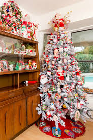 75 Flocked Christmas Tree by Gorgeous Flocked Christmas Tree With Vintage Santa Claus Doll