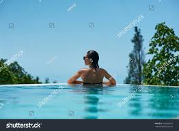 100 Infinity Swimming Young Woman Relaxing Pool Stock Photo Edit Now