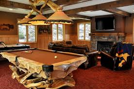 Country Man Cave With Stone Fireplace Rustic Pool Table Light Leather Sofa Wood