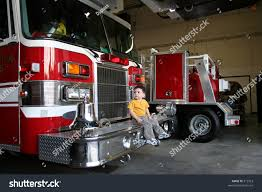 Toddler Boy Sitting On Looking Firetruck Stock Photo 312923 ...