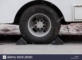 Wheel Chocks Placed Under Parked Truck - USA Stock Photo, Royalty ... Goodyear Wheel Chocks Twosided Rubber Discount Ramps Adjustable Motorcycle Chock 17 21 Tires Bike Stand Resin Car And Truck By Blackgray Secure Motorcycle Superior Heavy Duty Black Safety Chocktrailer Checkers Aviation With 18 In Rope For Small Camco Manufacturing Truck Bed Wheel Chock Mount Pair Buy Online Today Titan Wheels Gallery Pinterest Laminated 8 X 712