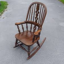 Wooden Rocking Chair In The Old Attic Sussex Chair Old Wooden Rocking With Interesting This Vintage Wood Childs With Brown Rush Seat Antique Child Oak Windsor Cane And Back Rocker Free Stock Photo Freeimagescom 1830s Life Atimeinlife Amazoncom Kid Rustic Kids Indoor Chairs Classic Details That Deliver Virginia House Cherry Folding Foldable