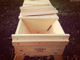 Feeding Bees In A Top Bar Hive – Day's Ferry Organics Langstroth Topbar Long Box By Eco Bee Eco Bee Box Modern Standard Top Bars For The Bkeeper Culture Feeding A Bar Hive Thirteenvegetables Frames Bkeeping Afloat Bees In Days Ferry Organics Like A Girl Langstroth Vs Top Bar Hive How To Avoid Crosscomb Topbars And Hives Overall Transfer Brood Comb From New Top Bar Topbarhive Backyard Blog Supering Cathedral New Hexagonal Youtube