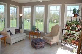 Modern Sunroom Design With A Cozy Corner Sofa Higher Back Chair Small Wood Side