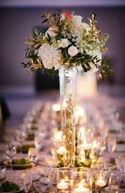 Tall Elegant Wedding Centerpieces With Gold Leaves The And Stems Are Inside