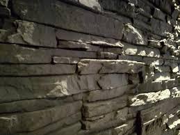 steinwand mauer wohnzimmer kamin stein wand fliesen