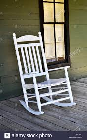 A White Wooden Rocking Chair Is Sitting On The Front Porch ... Front Porch Of House With White Rocking Chairs On Wooden Two Wood Rocking Chair Isolate Is On White Background With Indoor Chairs Grey Wooden Northbeam Acacia Outdoor Stock Image Yellow Fniture Club By Trex In Photo Free Trial Bigstock Small Old Toy Edit Now Karlory Porch Rocker 100 Pure Natural Solid Deck Patio Backyard Living Room Black Isolated
