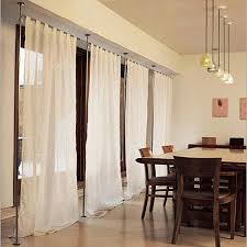 anywhere telescoping curtain system from umbra apartment therapy
