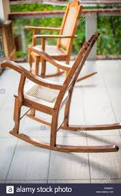 Wooden Rocking Chair On The Terrace Of An Exotic Hotel Stock Photo ... Wooden Rocking Chair On The Terrace Of An Exotic Hotel Stock Photo Trex Outdoor Fniture Txr100 Yacht Club Rocking Chair Summit Padded Folding Rocker Camping World Loon Peak Greenwood Reviews Wayfair 10 Best Chairs 2019 Boston Loft Furnishings Carolina Lowes Canada Pdf Diy Build Adirondack Download A Ercol Originals Chairmakers Heals Solid Wood Montgomery Ward Modern Youtube