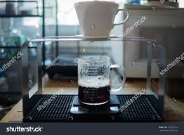 Making Coffee In The Morning With A Dipping Method Ceramic Dripper Is Placed On