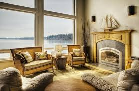 gemütliches wohnzimmer mit kamin und bild kaufen