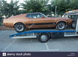1970's Brown Ford Mustang Mach 1 Recovery Truck Stock Photo ... 1976 Two Tone Combinations Ford Truck Enthusiasts Forums Flashback F10039s New Arrivals Of Whole Trucksparts Trucks Or Bf Exclusive 1970 F100 Short Bed Zzsled F150 Regular Cab Specs Photos Modification Info Exterior Chrome Trim Dennis Carpenter Restoration Parts Chevy C10 Vs Cj Pony Top 20 Most Popular Used Cars In The Us Motor Trend 1970s Brown Ford Mustang Mach 1 Recovery Truck Stock Photo F250 Crew Lowbudget Highvalue Image Gallery Flickr